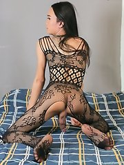 Here ladyboy Gina in sexy fishnets outfit. Feeling a little more naughty her hands grabs her cock and jerks it off until she cums!